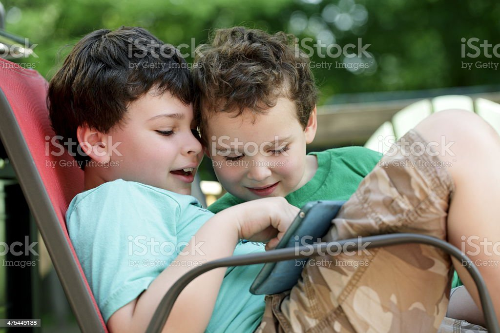Autistic children share tablet experience stock photo