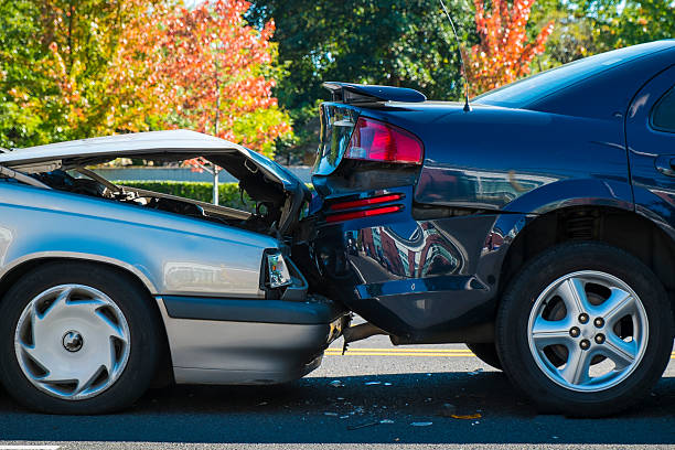 Auto accident involving two cars Auto accident involving two cars on a city street misfortune stock pictures, royalty-free photos & images