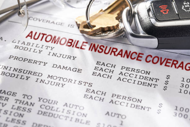 Auto and Car Insurance policy with keys stock photo