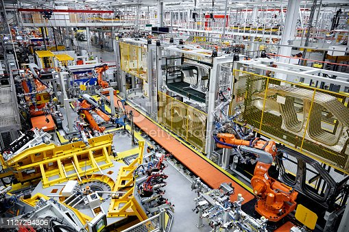 182463664 istock photo Auto body in car factory production line 1127294306
