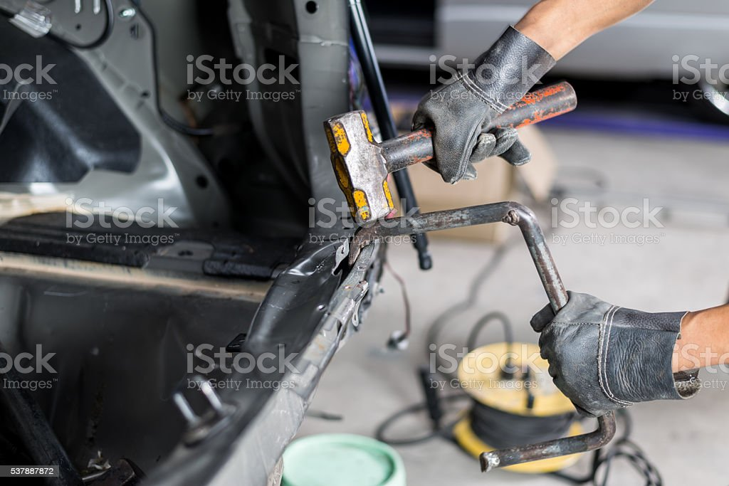 Auto body repair series : Fixing car body stock photo