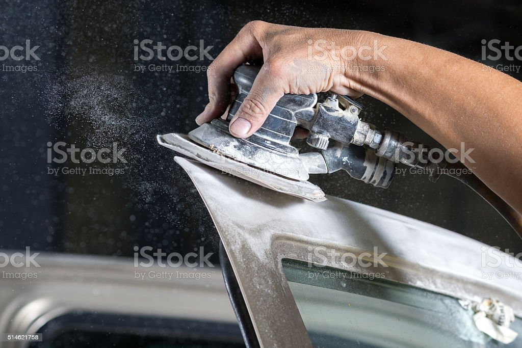 Auto body repair series : Sanding car paint stock photo