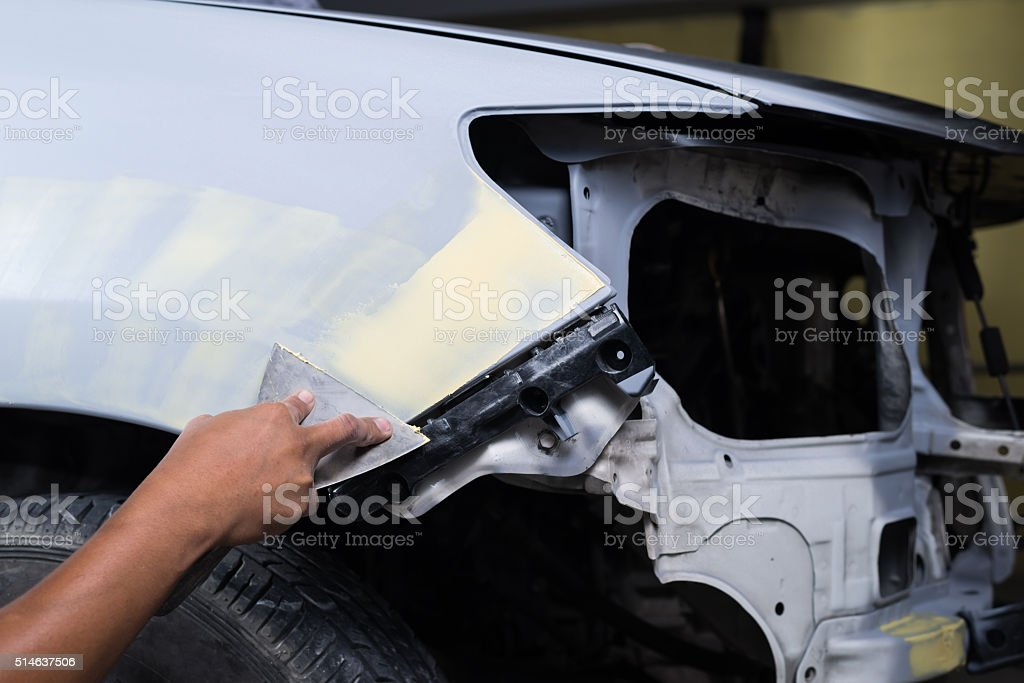 Auto body repair series : Working on putty stock photo