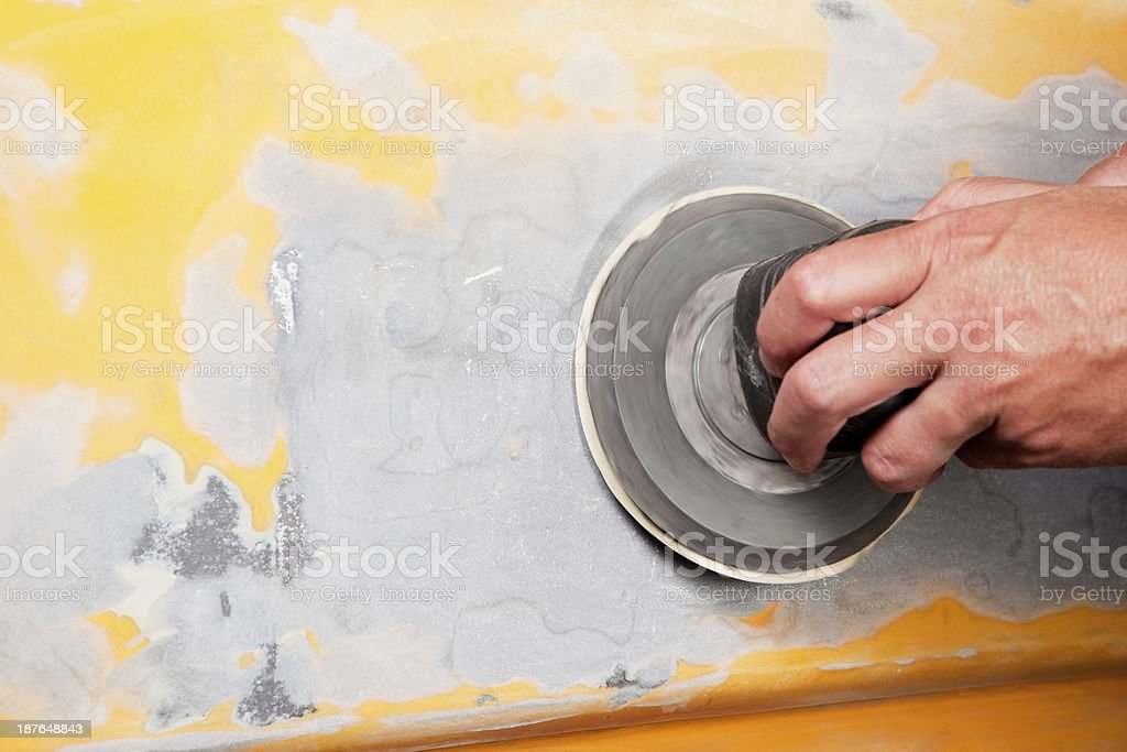 Auto Body Repair with Dual Action Sander on Filler stock photo