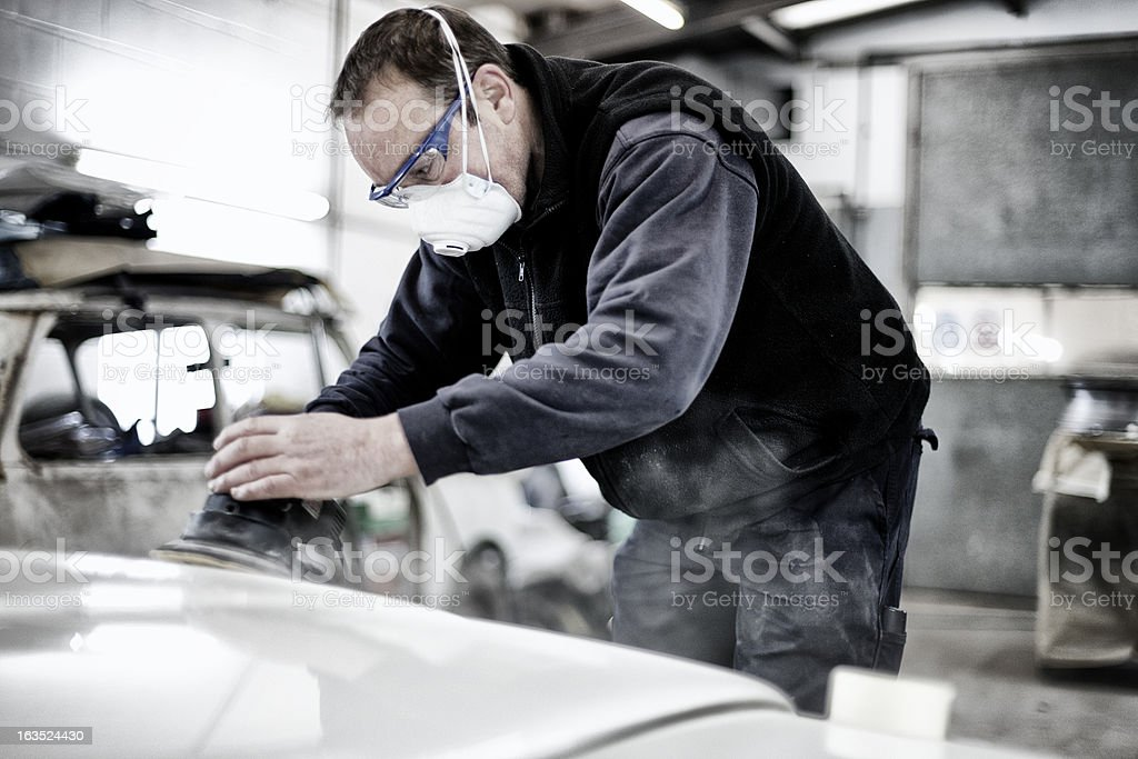 Auto body technician repairing a car stock photo