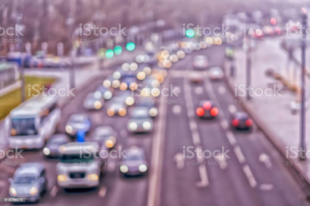 Auto, city street lights and traffic jams. Abstract toned blurred...