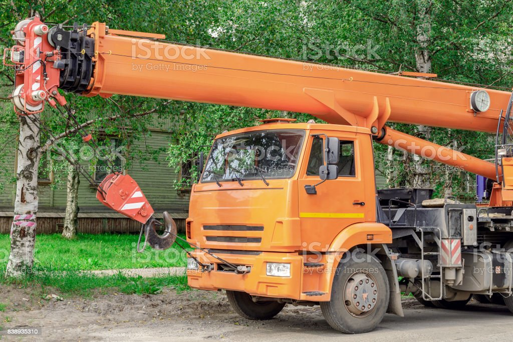 auto crane parked on the roadside stock photo