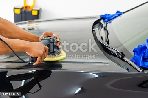 Man working for polishing, coating cars.