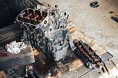 istock auto engine in garage 964871362
