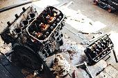 istock auto engine in garage 964883412