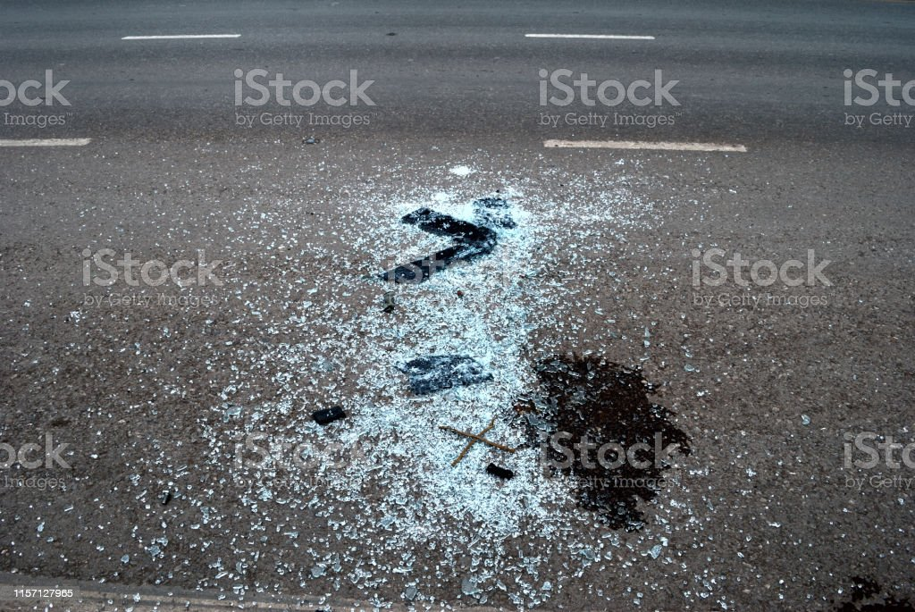 Broken glass on the road because of a car accident.