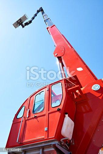 Auto hydraulic lift on sky background