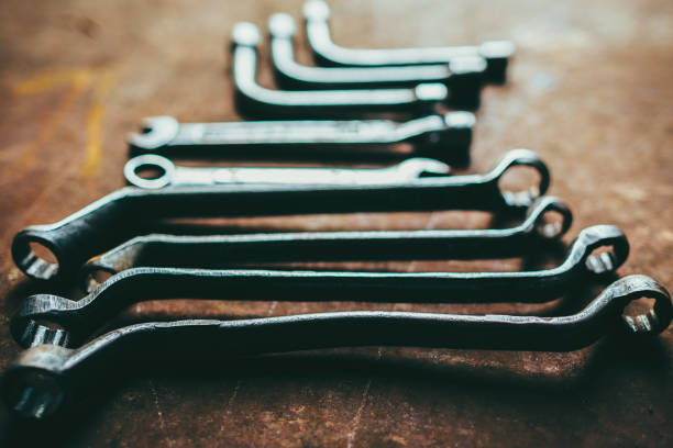auto maintenance service professional wrench set Auto maintenance service. Closeup of professional wrench set on rusty dark metal background. socket wrench stock pictures, royalty-free photos & images