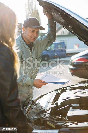 136591855 istock photo auto mechanic and female customer 521578243