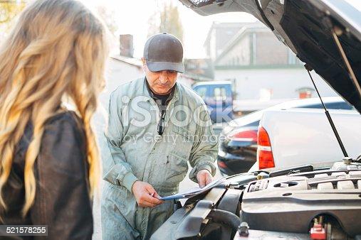 136591855 istock photo auto mechanic and female customer 521578255