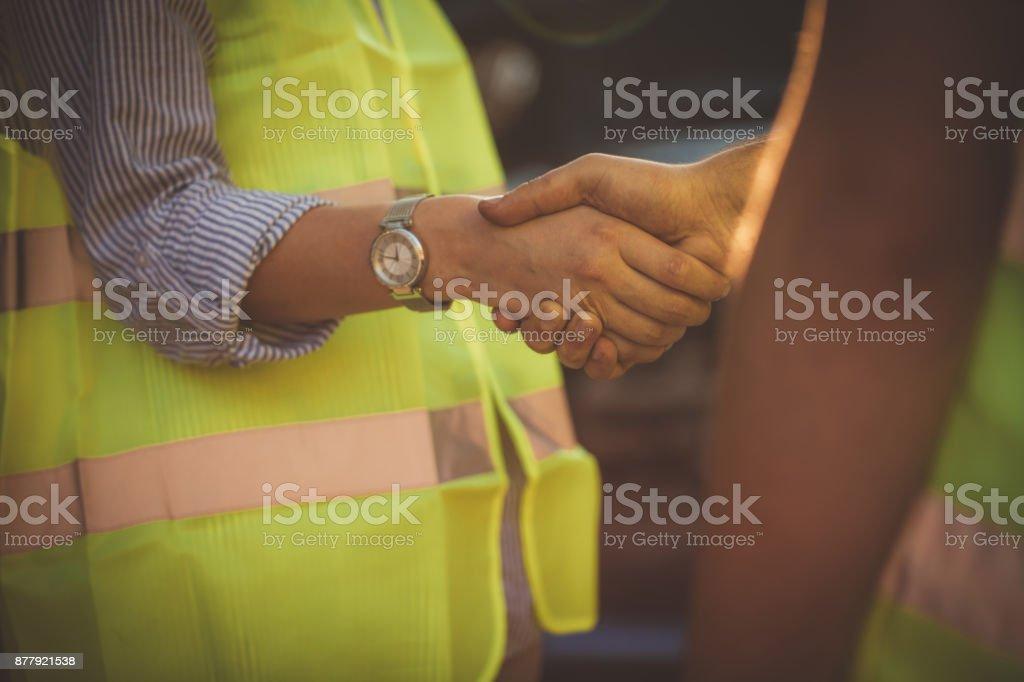 Auto mechanic and girl handshake stock photo