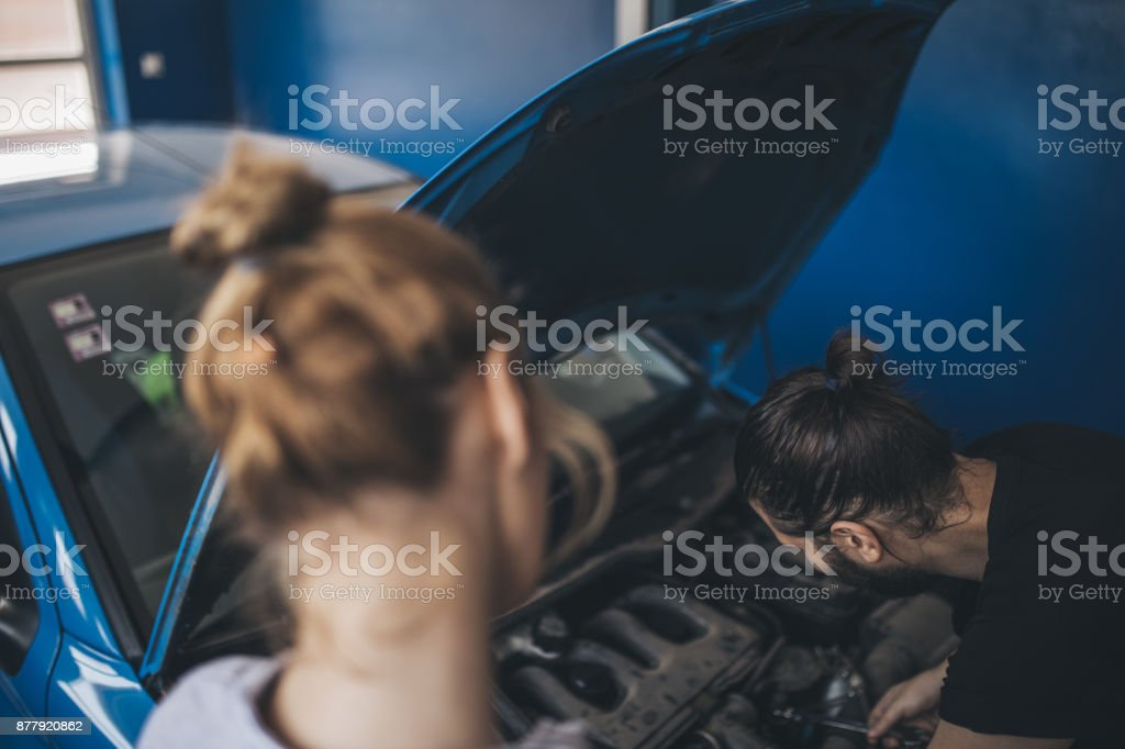 Auto mechanic and woman stock photo