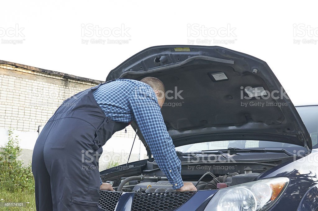 Auto mechanic at car engine repair work royalty-free stock photo