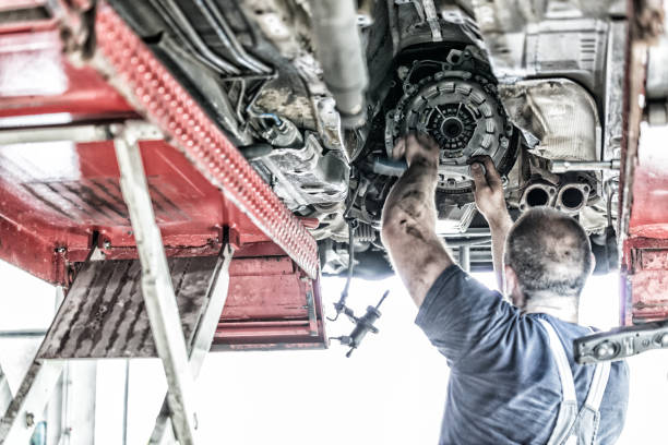Auto Mechanic at work Auto Mechanic at work vehicle clutch stock pictures, royalty-free photos & images