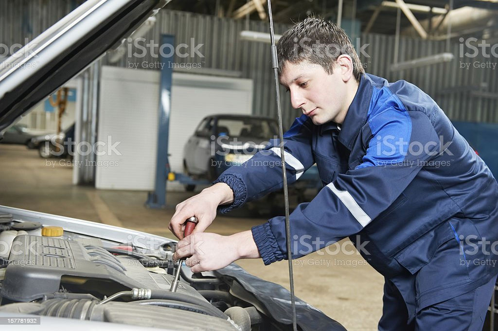 auto mechanic at work with wrench royalty-free stock photo