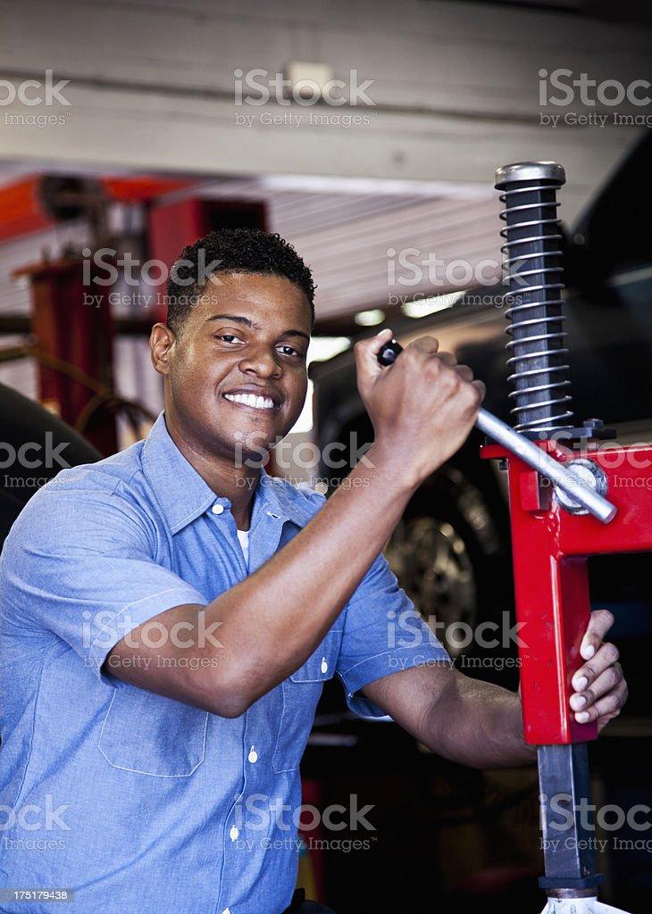 Auto mechanic attaching tire to rim stock photo