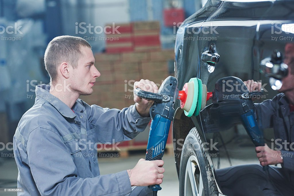 auto mechanic buffing car autobody stock photo