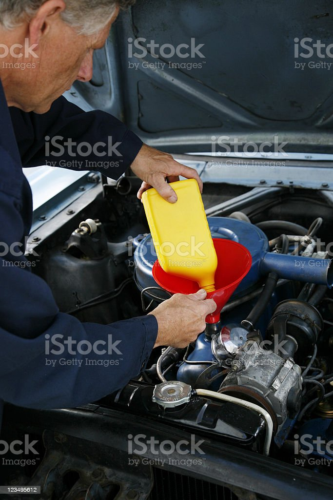 auto mechanic changing the oil stock photo