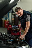 istock Auto mechanic checking car air conditioning system in a repair shop. 1191766752