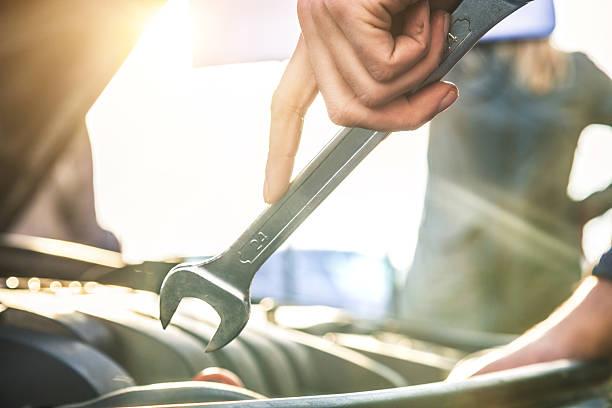 Auto mechanic fixing a car engine stock photo