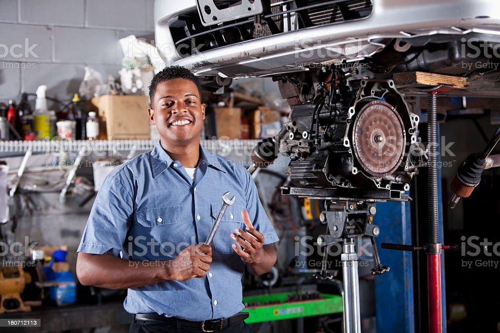 Auto mechanic fixing car transmission stock photo
