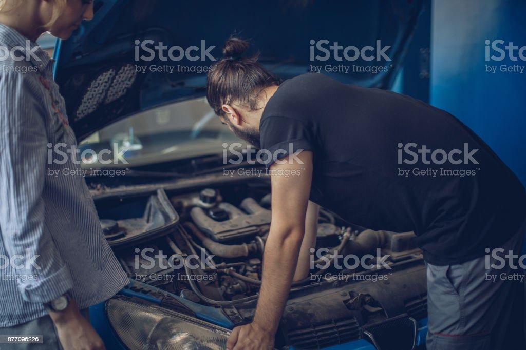 Auto mechanic helping customer stock photo