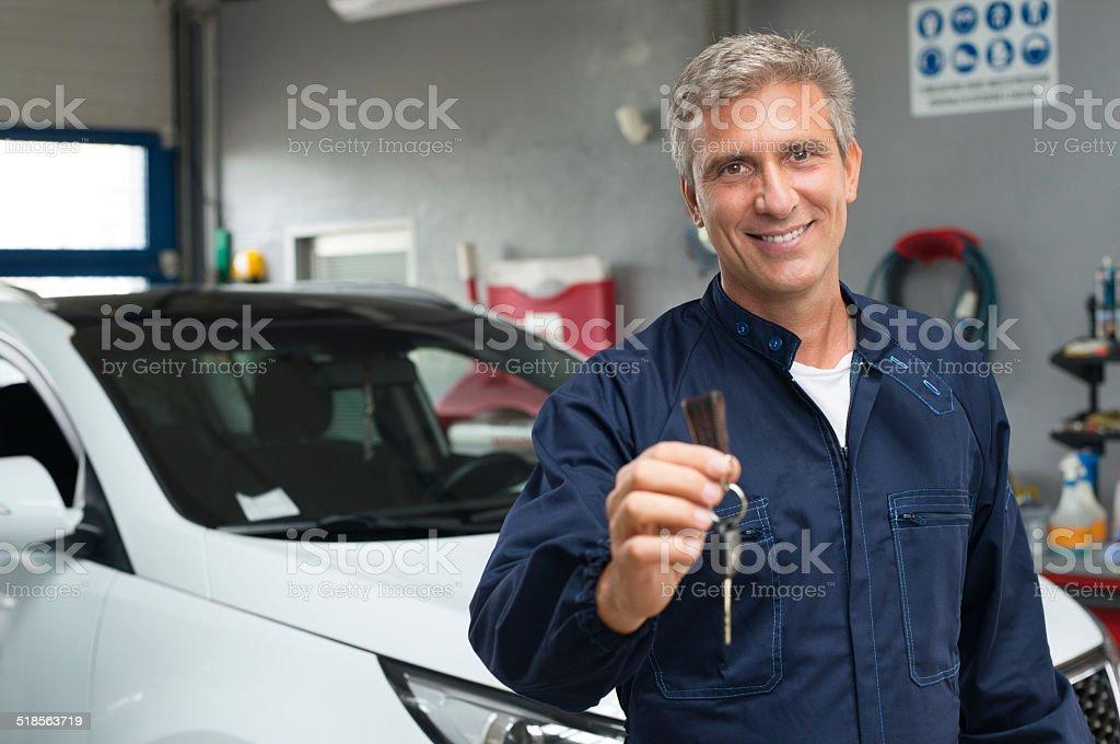Auto Mechanic Holding Car Key stock photo