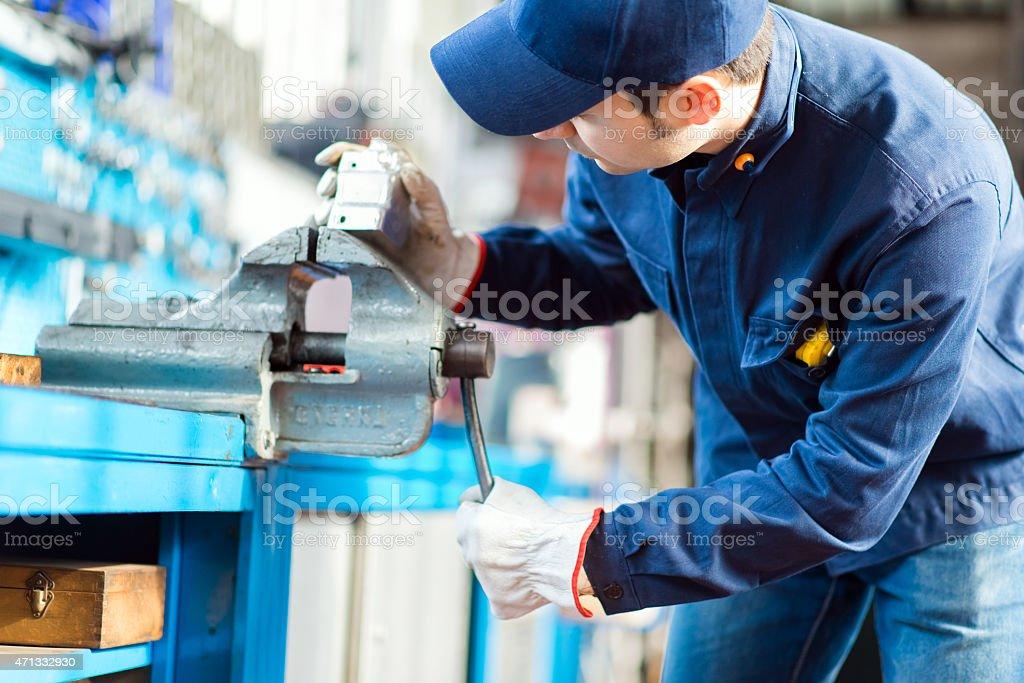 Auto mechanic in his workshop stock photo