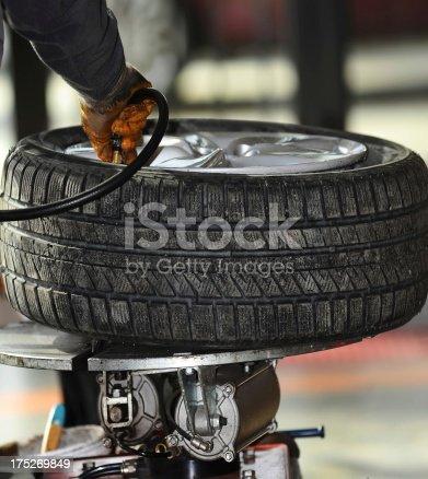 898487280 istock photo auto mechanic inflate tire 175269849