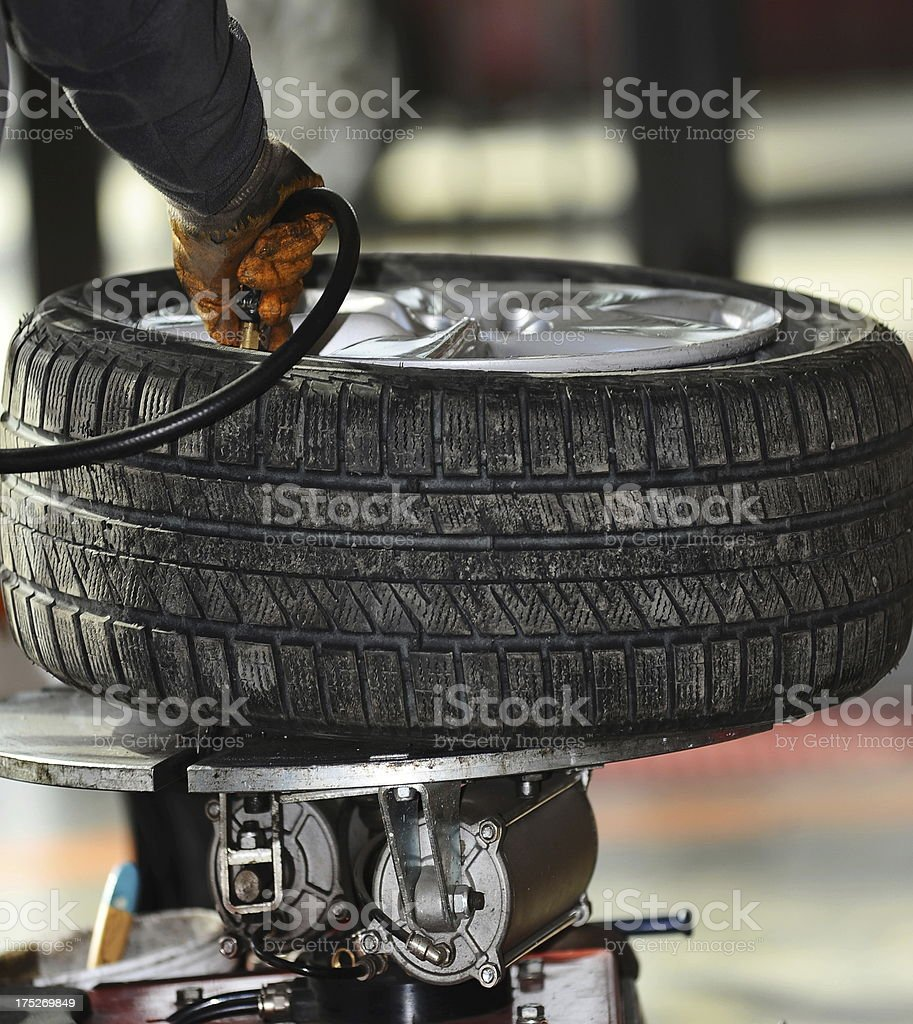 auto mechanic inflate tire stock photo