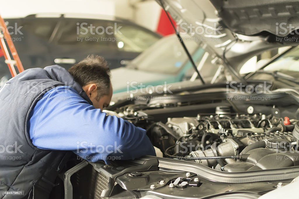 auto mechanic makes inspection and check a diesel engine car royalty-free stock photo