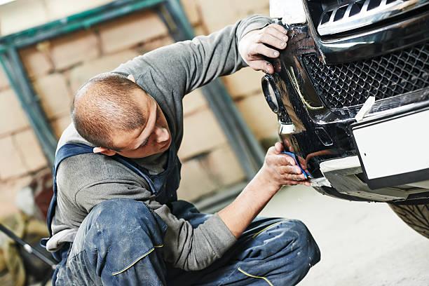 auto mechanic polishing car stock photo