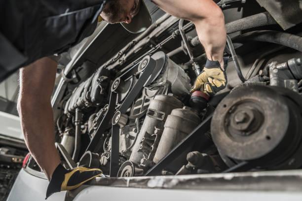 Auto Mechanic Repairing Bus Engine. stock photo