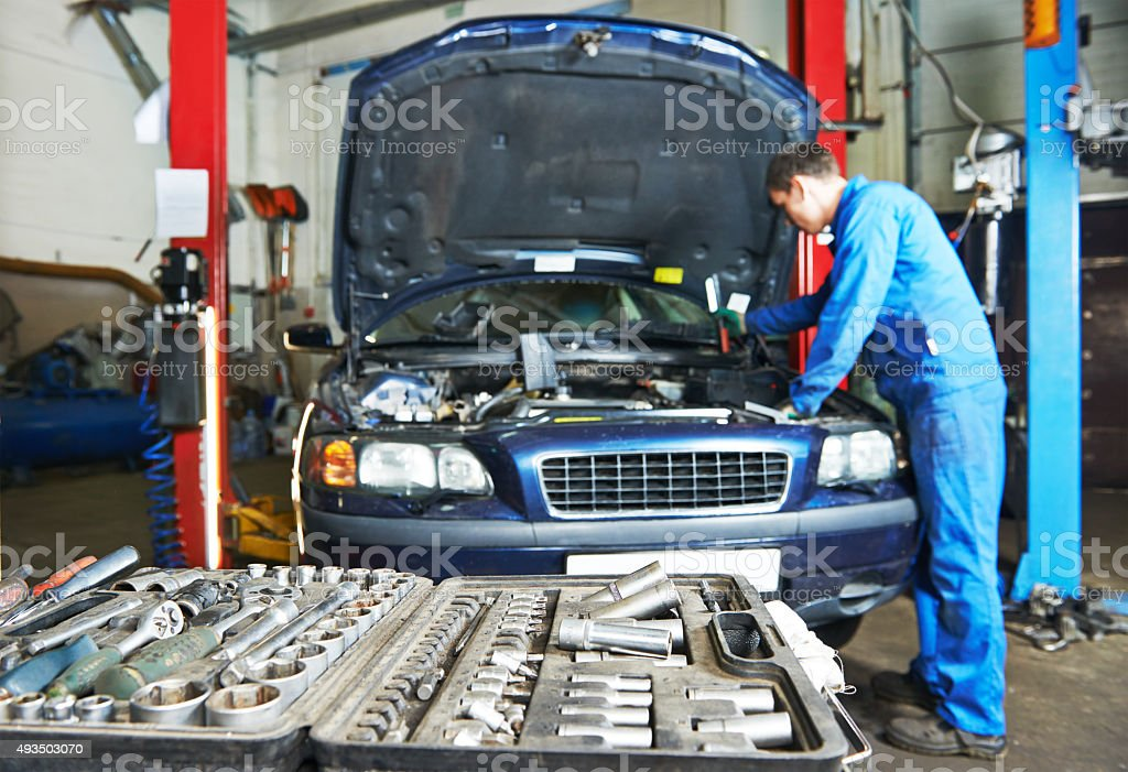 auto mechanic repairman at work stock photo