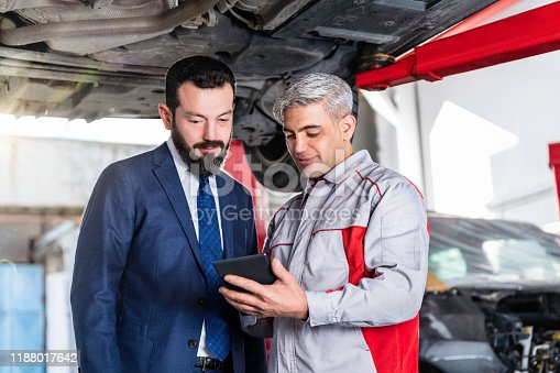 136591855 istock photo Auto Mechanic Showing Data on the Digital Tablet 1188017642