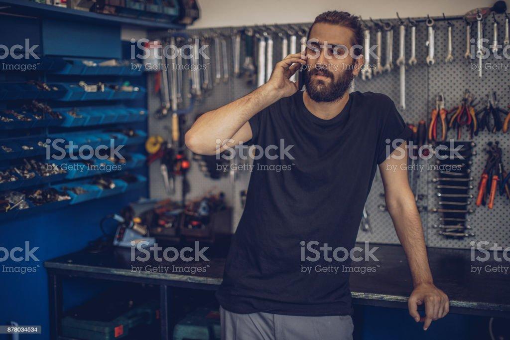 Auto Mechanic talking on phone stock photo