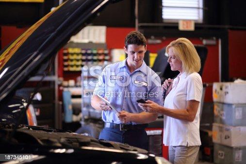 Auto Mechanic using digital tablet to show Customer completed workhttp://i449.photobucket.com/albums/qq220/iphotoinc/MobileBankingLightbox_zps4f4602a2.jpg