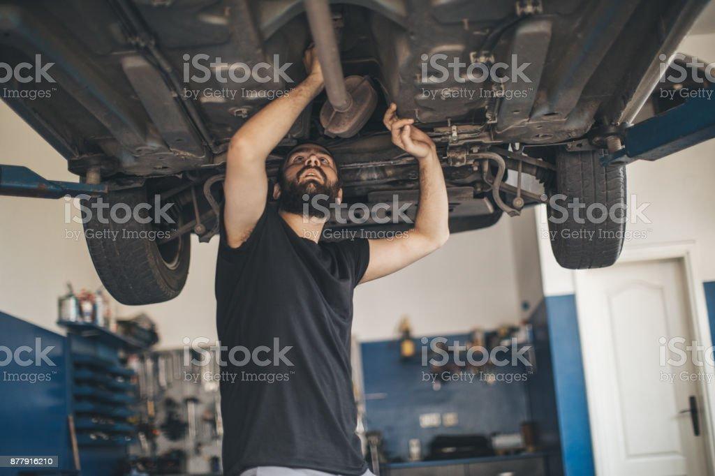 Auto mechanic working alone stock photo