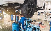 istock Auto mechanic working in garage. 1137474291