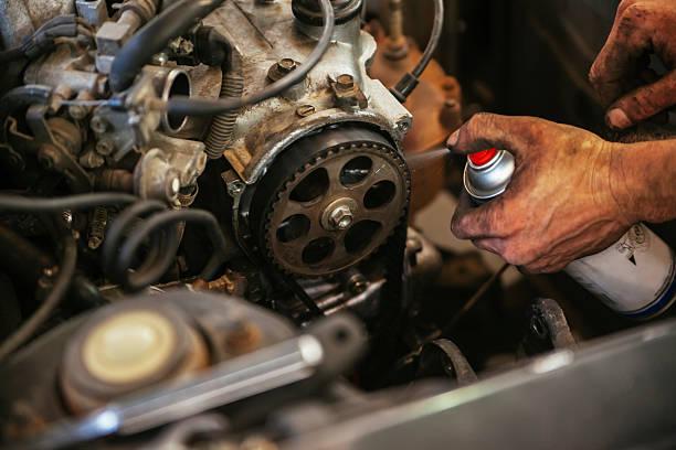 Auto Mechanic Working In Garage stock photo
