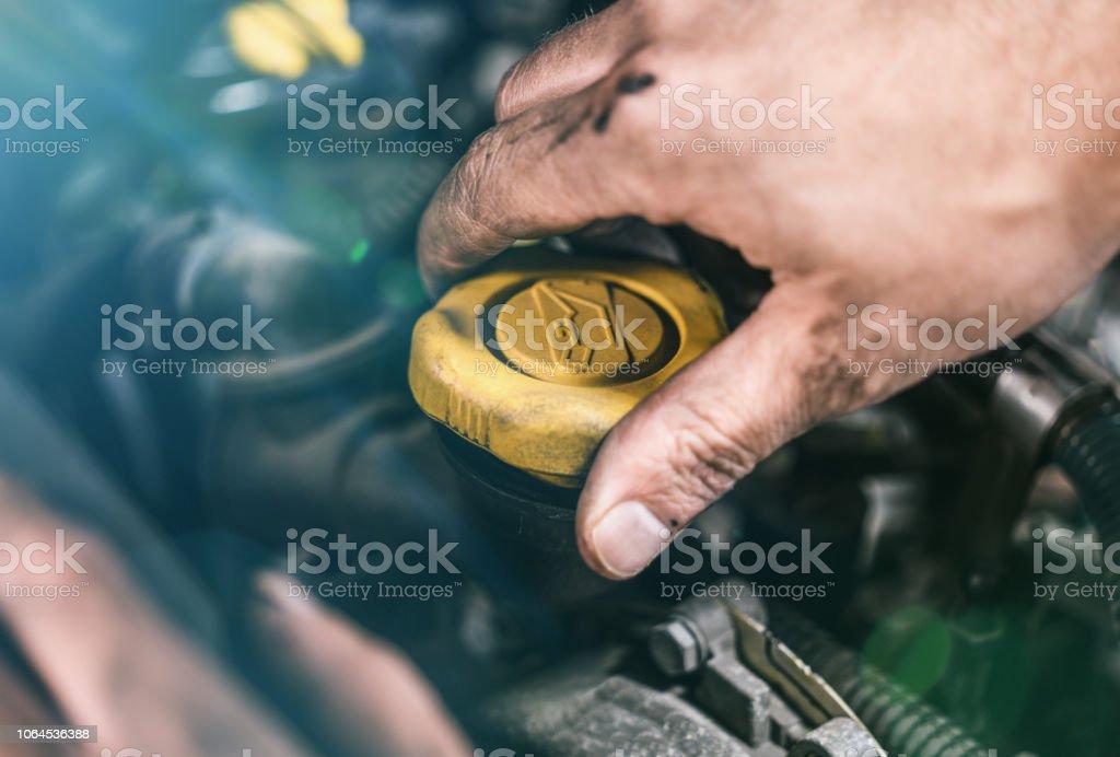 Auto mechanic working on car engine in mechanics garage. Repair...