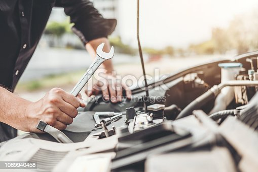 istock Auto mechanic working in garage Technician Hands of car mechanic working in auto repair Service and Maintenance car check. 1089940458
