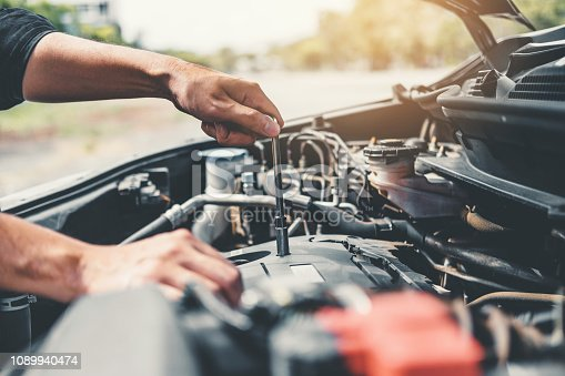 istock Auto mechanic working in garage Technician Hands of car mechanic working in auto repair Service and Maintenance car check. 1089940474