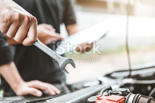 istock Auto mechanic working in garage Technician Hands of car mechanic working in auto repair Service and Maintenance car check. 1089940494