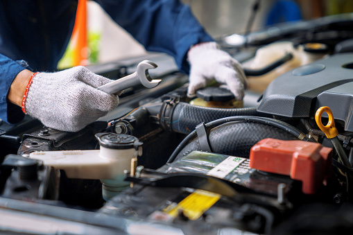 Auto mechanic working in the garage, Service and maintenance and car maintenance.